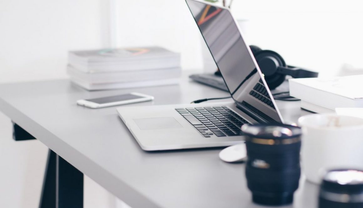 laptop and coffee on a desk