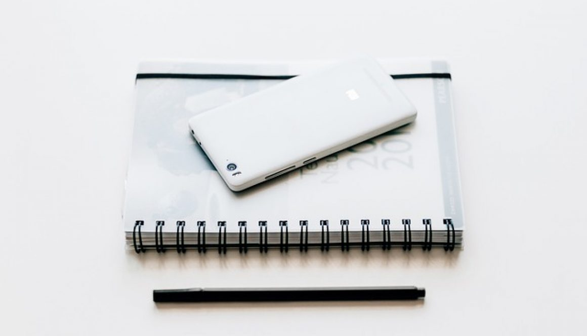 black and white notebook and pen